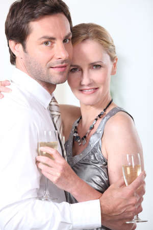 accomplices: portrait of a couple with champagne