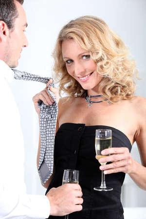 pulling beautiful: Woman pulling tie Stock Photo