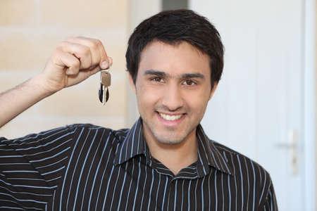 doorkey: Young man with a doorkey Stock Photo