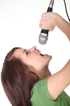 Woman yelling into a microphone photo
