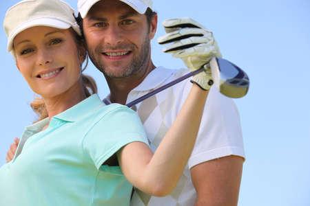 fair hair: Golfing couple Stock Photo