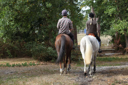 horse riding: Couple riding in the countryside