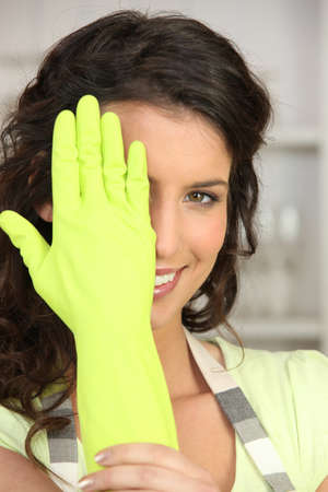 a woman wearing rubber gloves photo