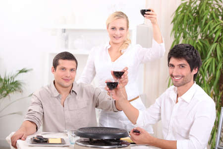 Friends enjoying a raclette photo