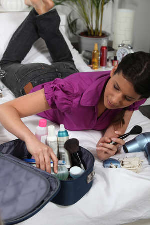 toiletry: Woman with variety of cosmetics