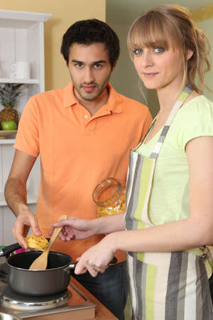 Couple cooking pasta photo