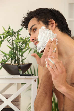 shaver: Man applying shaving foam