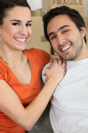 all smiles: young couple all smiles moving flats Stock Photo
