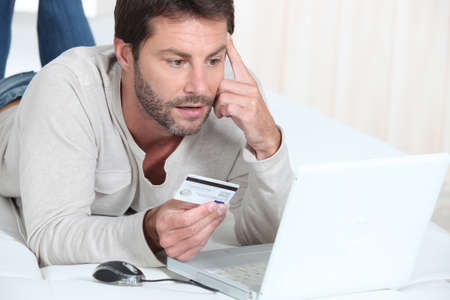 Man purchasing goods online Stock Photo - 12219462