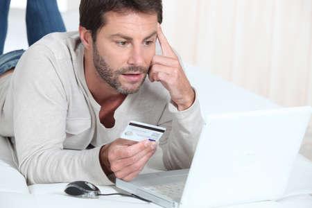 Man purchasing goods online photo