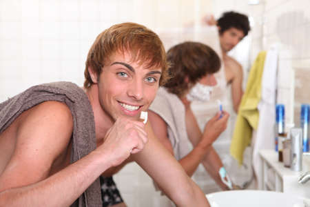 Guys in the bathroom photo