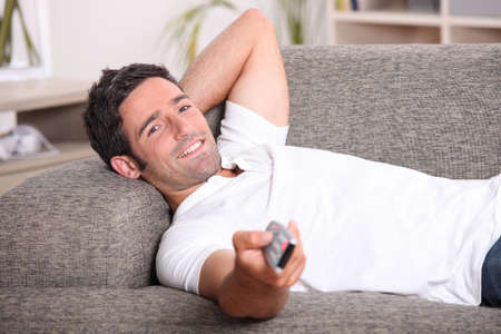 watching tv: portrait of a man watching TV Stock Photo
