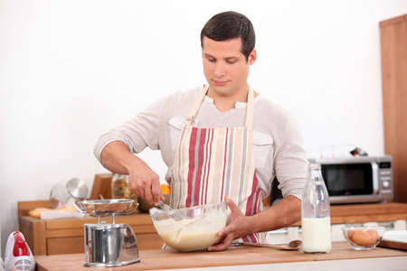 Man stirring mixture in bowl photo