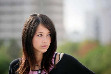 eurasian: Portrait of Eurasian girl outdoors Stock Photo