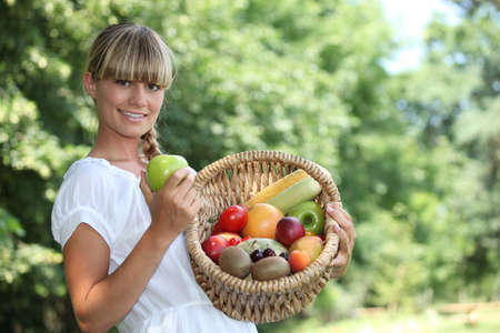 Woman with fruit basket photo