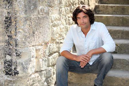 Man sitting on stairs photo