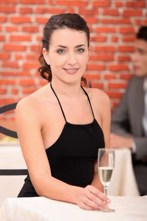 Woman in a chic bar drinking champagne photo