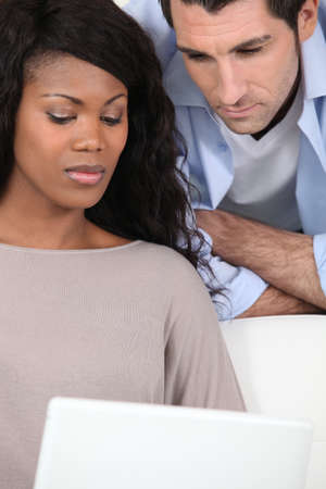 Man and woman in front of laptop photo