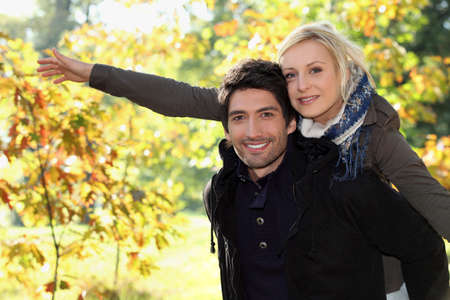 open country: Woman on man Stock Photo