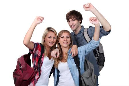 students with arms up photo