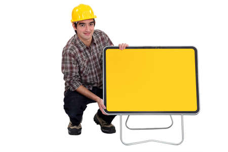 Laborer with empty road sign photo