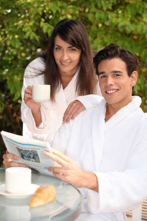 young couple on vacation having breakfast photo