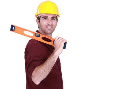 Tradesman carrying a spirit level Stock Photo - 12218804