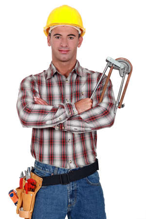 white color worker: A plumber with his arms crossed.