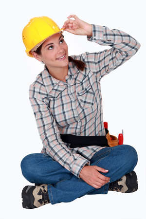 brim: Tradeswoman touching the brim of her hat