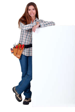 Handywoman with white panel for message photo