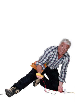 electrician falling down after an electrical shock Stock Photo - 12218861