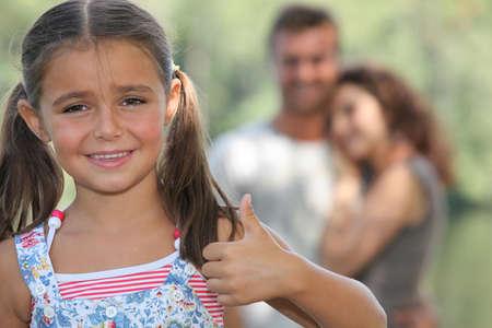 thumbsup: Little girl giving thumbs-up gesture