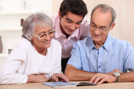 couple of senior citizens having their grandson home photo
