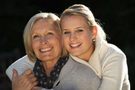 age 20 25 years: Young woman hugging her grandmother