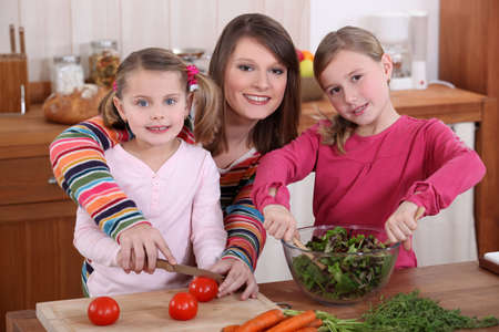 mother and daughters cooking together photo