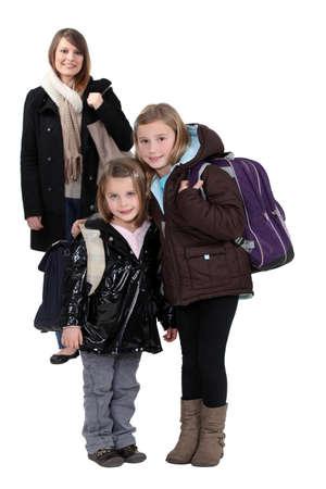 Mother with schoolgirls photo