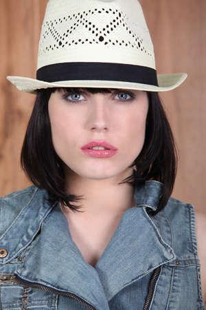 black hair blue eyes: Woman wearing a Panama hat