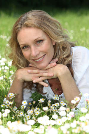 causcasian: Woman lying in the grass Stock Photo