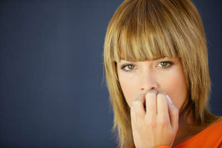 hassle: Woman biting her nails Stock Photo