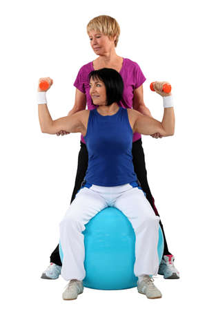 limber: Mature women working out Stock Photo