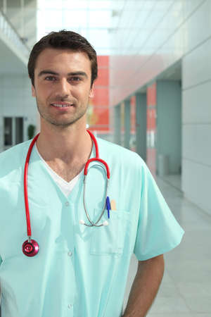 Portrait of a medical professional standing in a hallway photo