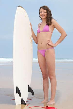16 17: Girl holding surf board
