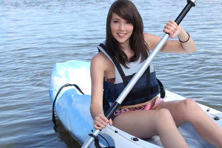 Teenage girl in row boat photo