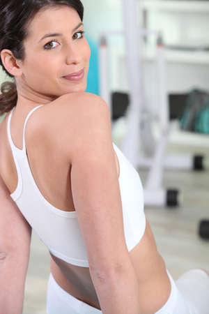 young brunette in fitness center photo