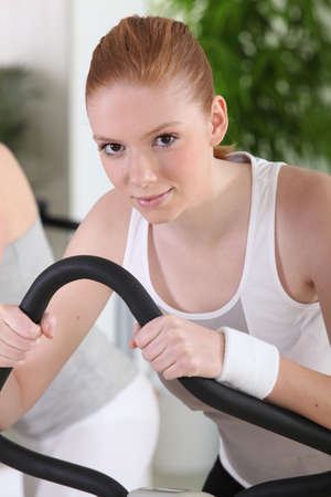 young woman training  in the gym photo