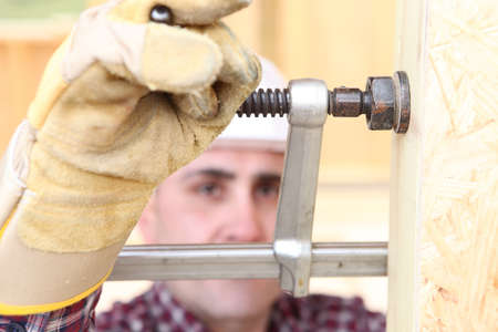 carpenter vise: Man using vice to secure wood