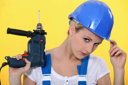 Woman with a power drill Stock Photo - 12219270