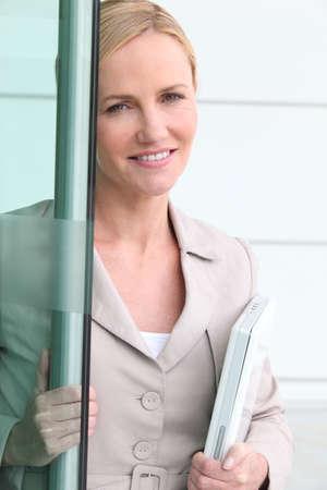 Businesswoman opening door photo