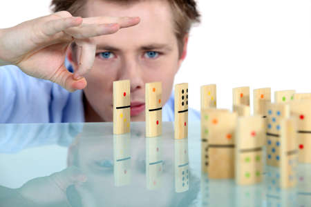 worried man: domino effect