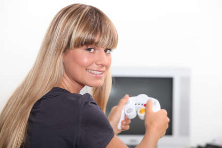 exclaiming: Young woman playing video game